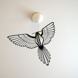 Bird Light - A great solution for a bare bulb, this figural bird slips on and adds instant glamour.