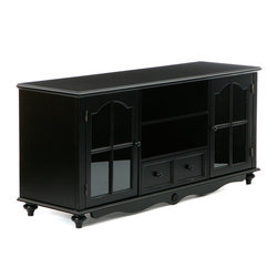 "Holly & Martin - Roosevelt Large TV Console, Antique Black - Finished in antique black, this media center utilizes two large open shelves in the middle above one large drawer to fit electronics and media equipment. There are window paned cabinet doors on either side housing one adjustable shelf each. The top of this piece measures 52"" wide by 16"" deep making it capable of holding a wide range of TV's and equipment. With so much space and the distressed antique it is sure to bring form and function into your home. The doors of the cabinets have glass windows and magnetic latches."