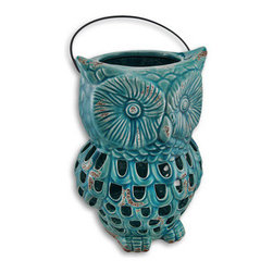 Ceramic Owl Lantern Open Work Design Blue - Entertain yourself and guests alike with the unique light show that will glow from this lantern! Light flows through the cutouts and dances on whatever surface it sits on. It is hand fired and painted with a glossy enamel, and has a touch of `oxidation` to give it that weathered appeal. It measures 10.5 inches tall, 7 inches across and 6 inches deep, has a 4 inch metal handle fits up to a 4 inch thick candle. Use a piller style for full effect, or a tea light for just a hint of lighting. A fun piece for your patio or to light the way into your backyard garden oasis.