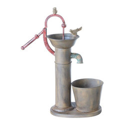 "Rusty Water Pump Planter - With its deep patina, this planter looks like it led an interesting life before reaching your home. The attached decorative water pump and spout, adorned with two perched birds, adds some vertical interest and offers support for a climbing plant. Holds one 6"" plant."