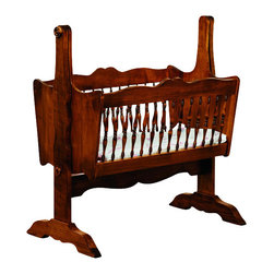 Chelsea Home Furniture - Chelsea Home Southampton Classic Baby Cradle Pad not Included in Brown Maple - This Classic Baby Cradle displays detailed artistry with embellished spindles and curved guardrails to add a touch of class to your nursery. Shown in Brown Maple with Medium Cherry stain, this cradle is both strong and aesthetically pleasing, allowing you to rock your baby to sleep in sophisticated style. Chelsea Home Furniture proudly offers handcrafted American made heirloom quality furniture, custom made for you. What makes heirloom quality furniture? It's knowing how to turn a house into a home. It's clean lines, ingenuity and impeccable construction derived from solid woods, not veneers or printed finishes over composites or wood products _ the best nature has to offer. It's creating memories. It's ensuring the furniture you buy today will still be the same 100 years from now! Every piece of furniture in our collection is built by expert furniture artisans with a standard of superiority that is unmatched by mass-produced composite materials imported from Asia or produced domestically. This rare standard is evident through our use of the finest materials available, such as locally grown hardwoods of many varieties, and pine, which make our products durable and long lasting. Many pieces are signed by the craftsman that produces them, as these artisans are proud of the work they do! These American made pieces are built with mastery, using mortise-and-tenon joints that have been used by woodworkers for thousands of years. In addition, our craftsmen use tongue-in-groove construction, and screws instead of nails during assembly and dovetailing _both painstaking techniques that are hard to come by in today's marketplace. And with a wide array of stains available, you can create an original piece of furniture that not only matches your living space, but your personality. So adorn your home with a piece of furniture that will be future history, an investment that will