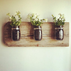 Mason Jar Wall Planter by Chateau Gerard - I can clearly imagine growing my herbs in these hanging jar pots.
