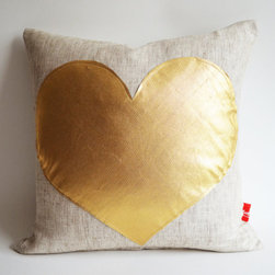 Gold Heart Pillow Cover by Sukan - This is one of my favorite pillows. It could work in pretty much any room and would look especially great during Christmastime.