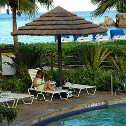 Thatch Umbrella - Natural - Natural Thatch Umbrellas can be used in any climate! Use as shade structures for your restaurant, cover the hot-tub, create a tropical ambiance on the patio or have the convenience of never taking down at your beach resort.