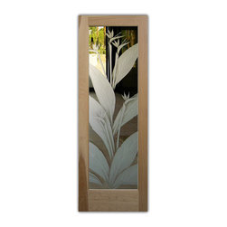 """Bird of Paradise 3D - Whether it's front entry doors, or interior glass doors the first focal point of any home, business or office are the doors, and art glass doors by Sans Soucie add a unique element and a level of luxury while providing privacy AND light!   From a little to a lot, the privacy you need is created without sacrificing sunlight.  From simple frosted glass effects to our more extravagant 3D sculpture carving, painted and stained glass and everything in between, Sans Soucie designs are sandblasted different ways which create not only different effects but different levels in price.  The """"same design, done different"""" - with no limit to design, there's something for every decor, regardless of style.  Price will vary by design complexity and type of effect:  Specialty Glass and Frosted Glass.  For complete descriptions of glass types and effects, click here.  Available any size, all glass is custom made to order and ships worldwide.  Door glass will be tempered and come in various thicknesses and types depending on door location (interior or exterior) and the effect selected.  Selling both the glass inserts for doors as well as door frames, Sans Soucie doors are available as an interior or entry door in 8 woods and 2 fiberglass, as a slab door or prehung in the jamb in any size.  Inside our incredibly fun, easy to use online Door Designer, you'll get instant pricing on everything as YOU customize your door and glass!  When you're all finished designing, you can place your order online!   We're here to answer any questions you have so please call (877) 331-339 to speak to a knowledgeable representative!   Doors ship worldwide at reasonable prices from Palm Desert, California with delivery time ranges between 3-8 weeks depending on door material and glass effect selected.  (Doug Fir or Fiberglass in Frosted Effects allow 3 weeks, Specialty Woods and Glass  [2D, 3D, Leaded] will require approx. 8 weeks)."""