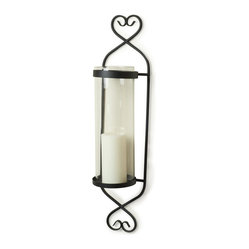 "Danya B. - 24"" Classic Cylinder Wall Sconce - Guaranteed to warm your heart, this sweet sconce will add illumination and rustic loveliness to your wall as well. Crafted from black twisted wrought iron, it features a recycled glass hurricane for holding your favorite pillar candle."