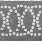 Nile Bath Mat - Soft spot. The Nile Bath Mat sports a circular pattern of dots in tufted cotton that feels warm and welcoming on wet feet. Reversible in Feather Gray, it would also work well in an entryway or kitchen.