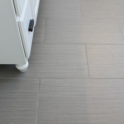 "Daltile Fabrique Creme Linen - This image features Daltile's series Fabrique. The product color is called Creme Linen. It is featured here in a 12"" x 24"" format. This striated tile look is particularly liked by our customers."