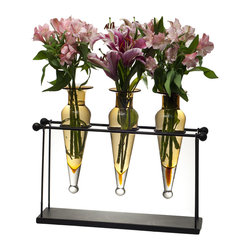 Danya B. - Triple Amphorae on Iron Stand with Finials Vases - Sophistication and structure are perfectly melded in this stunning display of three glass vases in a rustic iron stand. This unique centerpiece will look refined filled with flowers on your mantle or credenza.