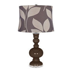 """Color Plus - Contemporary Carafe Sand Leaves Shade Apothecary Table Lamp - Carafe brown glass table lamp. Gray fabric drum shade with sand color leaf design. Lucite base. Maximum 150 watt or equivalent bulb (not included). On/off switch. 30"""" high. Shade is 15"""" across the top 16"""" across the bottom 11"""" on the slant.   Carafe brown glass table lamp.  Gray fabric drum shade with sand color leaf design.  Lucite base.  Maximum 150 watt or equivalent bulb (not included).  On/off switch.  30"""" high.  Shade is 15"""" across the top 16"""" across the bottom 11"""" on the slant."""