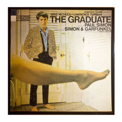"""Glittered 'The Graduate' Album - Glittered record album. Album is framed in a black 12x12"""" square frame with front and back cover and clips holding the record in place on the back. Album covers are original vintage covers."""