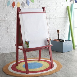 Classic Playtime Junior Easel - Licorice Red - If your kid could have drawn that then maybe you should get started on your retirement and plunk them down in front of the Classic Playtime Junior Easel - Licorice Red. This double-sided easel provides the perfect surface for your child to draw sketch or scribble on a long roll of paper with the crayon or marker of their choice. A wide tray gives them room to store all the colors they need and a central shelf adds extra storage for art supplies while it also gives a bit of extra stability. The easel is crafted from durable medium-density fiberboard (MDF) with a bright licorice red finish. About Classic PlaytimePlaytime doesn't require batteries or a screen and providing kids with a place to grow and learn doesn't require sacrificing your home's integrity. Classic Playtime is devoted to the idea that given constructive ways to explore their world and themselves children blossom in their own gardens. Our furniture is designed to be simple unique and functional in both kids' and adults' spaces. You'll find stylish and practical places for art activities reading writing building and somewhere to keep it all during downtime.