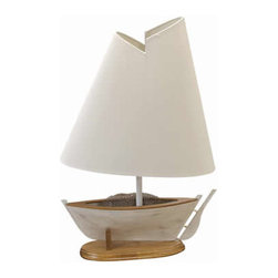 """Boat Lamp - The boat lamp measures 13"""" x 5"""" x 21"""". It features a boat with netting inside of it attached to a sturdy wood base. The shade has a very unique look to it. The lamp can take up to a 100 watt bulb but we recommend a 60 watt bulb just to be safe. It will add a definite nautical touch to wherever it is placed and is a must have for those who appreciate high quality nautical decor. It makes a great gift, impressive decoration and will be admired by all those who love the sea."""