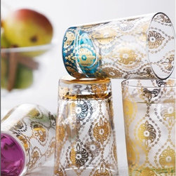 Moroccan Style Tea Glasses - Set of Four - Moroccan style became very popular a few years back and like the original designs themselves, the trend has staying power. Exotic and intricate, these gold glasses from Horchow are a luxurious treat to add to your loved one's barware.