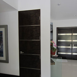 """Contemporary Euro Doors - Bathroom and bedroom Italian interior doors very contemporary with """"european look"""" with stainless strips applied to flush doors to concept with the overall look of the modern home. Doors manufactured flush."""