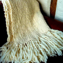 Flame Natural Ivory Throw - This 'Flame Throw' is a fluffy & richly textured cable wool throw. Almost a 'must' piece, if you want to décor your house as a trendy & chic home. Volumes of thick cable corriedale wool yarn have been loosely hand woven together into chunky cable knots.  Finished with extra long hand knotted fringes - this really is a forever piece finished to ensure the highest quality, softness and comfort.