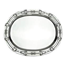 Arthur Court - Equestrian Oval Platter - The beauty and romance of English horseback riding is celebrated in this handsome oval tray. Images of horse tack adorn the rim of this cast-aluminum piece, which travels easily from refrigerator or freezer to table. It's an ideal gift for someone who loves horses or admires the rituals and traditions that attend them.