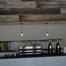 Original Faded White & Gray Barn Wood - The barn wood for this accent wall was provided by Reclaimed DesignWorks.