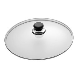 Scanpan Classic 9 1/2 Inch Glass Lid - The Scanpan Classic 9 1/2 Inch Glass Lid is designed to fit your 9 1/2 inch Scanpan Classic cookware pieces. The dome shaped lid allows you to check on the progress of your food while keeping moisture in the pan. Constructed of tempered glass.
