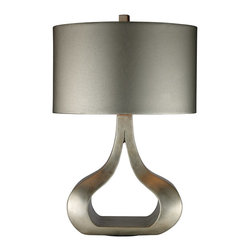 Dimond - Dimond Carolina Contemporary Table Lamp X-0481D - This Dimond contemporary table lamp from the Carolina Collection features a traditional inspired design with clear modern influencing. The unique look of the classic-yet-modern base is highlighted by the Silver Leaf finish while the oval metallic silver faux leather shade pulls the entire design together, creating a sleek and cohesive look.