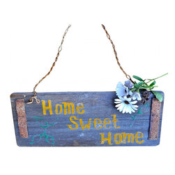 "Wood Sign - Reclaimed barn wood in metal strapping proudley says ""Home Sweet Home"".  Barb wire hanger with handpainted words in yellow.  Measurments: 15""6 x 6"""