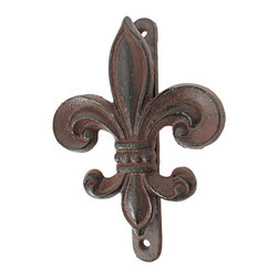 Rustic Cast Iron Fleur De Lis Door Knocker - This beautiful cast iron Fleur De Lis symbol door knocker is an excellent addition to the front doors of New Orleans Saints fan, people of French descent, or any member of royalty. It is finished with a brown enamel that mimics rust, and gives the knocker an aged look. The knocker measures 8 inches tall, 5 inches wide, 1 3/4 inches thick, and has 2 screw holes in the main plate for mounting to your door. It has wonderful detail and the aged finish looks great on any color door. The mount doubles as a striker protector, so it won`t mar your door.