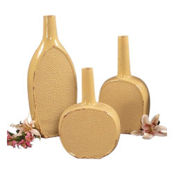 None - Distressed Pale Yellow Glaze Ceramic Bottles (Set of 3) - These decorative bottles constructed of ceramic are specially distressed in a delightful yellow glaze. Add instant style to any decor setting with these sandwich pressed texture vases.