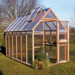 Sunshine - Sunshine Mt. Hood 6 x 12 Foot Greenhouse Kit - MRY017 - Shop for Greenhouses from Hayneedle.com! Additional FeaturesDoor measures 28W x 78H inchesPeak height measures 8.4-feetComes with 12-feet of wood stagingStaging runs the length of the greenhouseStaging gives you versatility and more planting spaceIncludes a 12L x 12H foot shade coverCools your greenhouse up to 15 degreesReduces the amount of sunlight aiding in plant growthCan double as a windscreen in the colder monthsDoes not take long to assembleIncludes printed instructions and an assembly videoComes with a 5-year warrantyFor those with limited space who still want to grow their own organic fruits and vegetables as well as enjoy their favorite flowers the Sunshine Mt. Rainier 6 x 12 Foot Greenhouse Kit comes with everything you need. With a beautiful clear natural and sturdy redwood frame and twin polycarbonate panels designed to protect your plants this greenhouse looks fabulous as well. The large Dutch doors allows you to keep the door open without worrying about little critters getting in and the doors and base are both made with recycled plastic. The four vents with automatic openers allows for plenty of air ventilation helping to keep your plants healthy. A 12-foot staging area is included which can double as a work station and gives you more room for growing plants. A shade cover is also included so you have greater control over the climate of your greenhouse and it can also double as a wind screen in colder months. Measuring 12L x 6W x 8.4H feet this greenhouse is large enough for all your growing needs. With preassembled panels this greenhouse does not take long to assemble. Printed instructions as well as an assembly video are included.