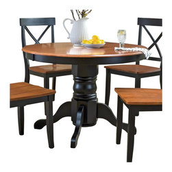 Home Styles - Home Styles Round Pedestal Casual Dining Table in Black and Cottage Oak Finish - Home Styles - Dining Tables - 516830 - The Home Styles Dining Table is constructed of solid hardwood in a multi-step black and cottage oak finish. It features a round shaped wood top and a pedestal base. Suitable for four the transitionally styled Home Styles Dining Table is an ideal central fixture in your dining area or kitchen.Features: