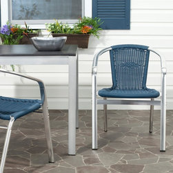 Safavieh - Safavieh Wrangell Stackable Dining Chair - Set of 2 - FOX5207C-SET2 - Shop for Chairs and Sofas from Hayneedle.com! The Safavieh Wrangell Stackable Dining Chair - Set of 2 is a celebration of paradoxical compliments. An updated twist on traditional patio seating these chairs work with either a classic decor or more contemporary styling. The cool hard aluminum frame plays off the softer-looking wicker-weave seat and back. Meanwhile both provide a durability of material and construction that makes this piece ideal for extra seating either indoors or out.About SafaviehConsidered the authority on fine quality craftsmanship and style since their inception in 1914 Safavieh is most successful in the home furnishings industry thanks to their talent for combining high tech with high touch. For four generations the family behind the Safavieh brand has dedicated its talents and resources to providing uncompromising quality. They hold the durability beauty and artistry of their handmade rugs well-crafted furniture and decorative accents in the highest regard. That's why they focus their efforts on developing the highest quality products to suit the broadest range of budgets. Their mission is perpetuate the interior furnishings craft and lead with innovation while preserving centuries-old traditions in categories from antique reproductions to fashion-forward contemporary trends.