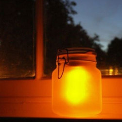 MoMA Store - SunJar - This frosted mason jar preserves sunlight, which powers its LED lights to keep things illuminated at night. It makes a great candle or flashlight alternative outdoors, and it's watertight, so it's no big deal if you leave it outside morning, noon, and night.