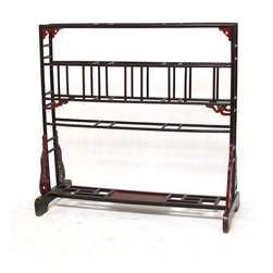 Large Chinese Lacquered Garment Rack - Antique large Chinese lacquered garment rack from the Shanxi Province of China. Since the concept of closets did not exist, the clothes rack served as a hanger for clothes that had just been shed. Racks like this were common pieces of furniture in the sleeping quarters of men and women. This one is a double wide style with an open fretwork bottom. Dark finish with original red lacquer highlights. Circa 1800's with age appropriate wear.