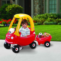 "Little Tikes - Cozy Coupe with Trailer - Features: -Cozy coupe with trailer. -For three decades, the Cozy Coupe has been a family favorite. -Little Tikes is celebrating the 30th anniversary of their Cozy Coupe with a new design to make this classic ride on even more lovable. -New Cozy Coupe design includes removable floor and handle on back for parent controlled push rides. -Door opens to make it easy for kids to hop inside. -Designed with a high seat back and storage in the rear. -Includes special features like an ignition switch"" and an open and close gas cap. -Cozy rolls on rugged, durable tires, front wheels spin 360º. -Can pull another child, dolls, or toys. -Designed for both indoor and outdoor play. -Includes trailer hitch to allow it to be towed. -Suitable for age: 18 months - 5 years old. -Made in the USA. -Assembly required."