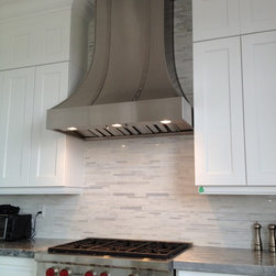 Custom Range Hoods - Custom fabricated range hood from stainless steel with brushed stainless steel decorative bands and crown. 600cfm high performance internal blower, dimmable halogen lighting and dishwasher safe baffle filters