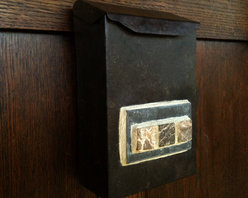 Bungalow Street Mailbox - This Arts and Crafts mailbox is small in size but large in Bungalow style. Crafted from galvanized steel and finished to a faux vintage, rusted iron patina. The front is adorned with slate and 3 marble tiles.