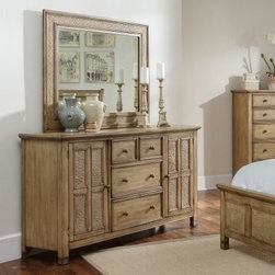Progressive Furniture Kingston Isle II 4 Drawer Dresser - Sand - Breezy, tropical glamour for your master bedroom. The Progressive Furniture Kingston Isle II 4 Drawer Dresser - Sand offers storage and style. This dresser has an exotic look accentuated by hand-woven rattan accents, antique brass tropical hardware, and a multi-step sand finish. Well-constructed, too, it features metal-on-metal drawer guides plus French and English dovetail drawers. Central drawers and two cupboard doors creative plenty of storage. A hand-woven rattan mirror (sold separately) is a perfect match. These pieces are part of the tropical-inspired Kingston Isle II collection.About Progressive Furniture Established in 1985 in Hickory, North Carolina by several investors who had a vision to shape a successful furniture company, Progressive Furniture has thrived ever since. They began manufacturing and distributing occasional tables and naturally started creating bedroom furniture. By 2001, Progressive furniture had become a major force in U.S. furniture manufacturing covering the likes of several markets including: occasional tables, bedroom furniture, entertainment centers, and dining room furniture. Around that same time, Progressive Furniture was acquired by Sauder Woodworking and became a part of the Sauder family of companies. Together, they soon became the 7th largest furniture manufacturing company in the world. Today, Sauder and Progressive operate facilities in Ohio, North Carolina, California, Mexico, and China, including additional partnerships with factories in Indonesia, Vietnam, and Hong Kong. Progressive remains at the top of the industry and has been a trusted manufacturer for over 25 years.