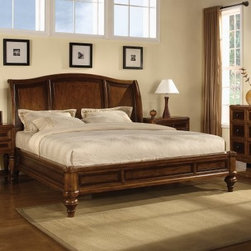 Brendon Sleigh Bed Set - The holidays come once a year but the Brendon Sleigh Bed will be a beautiful addition to your bedroom year round. A hazelnut and cabernet finish complements the shape of this bed. Headboard Dimensions: Queen: 65.75W x 11D x 58H inches King: 81.75W x 11D x 58H inches Complete Bed Dimensions: Queen: 68.25W x 94.5D x 58H inches King: 84.5W x 94.5D x 58H inches The Brendon Sleigh Bed is beautiful and so are the matching collection pieces. Choose from the following optional bedroom furniture pieces: one or two nightstands a chest and a dresser with optional mirror. The nightstands each have two drawers the chest has five drawers and the dresser has nine drawers. All items are crafted from mahogany with cherry and birch veneers and finished in a hazelnut and cabernet color. The matching landscape mirror is simple and adds a nice touch to the set. Bedroom Furniture Dimensions: Nightstand: 29W x 18D x 30H inches Chest: 40.25W x 20D x 52H inches Dresser: 66W x 21D x 38H inches Mirror: 48W x 2D x 39H inches About Wynwood FurnitureAt Wynwood designing unique and useful furniture is the goal. The company's own fashion consultants scour the globe for distinctive woods and eye-catching designs before bringing their findings back home to talented designers who set about creating beautiful pieces. The designs are then moved into production where Wynwood specializes in ensuring all collections are both stunning and useful giving every piece a thorough going-over that results in inimitable style impeccable construction and unequaled functionality.