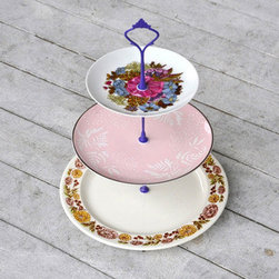 Vintage China Cupcake Stand - Imagine how darling your cupcakes will look atop this delicate three-tiered dish. Featuring floral patterns with notes of pink and purple, this elegant piece will make a splash at your wedding or shower.