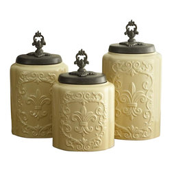 """Jay Companies - Antique Fleur De Lis Cream Canister Set - Treat yourself with our high quality Antique Cream Colored Canister Set. Perfectly carved of fine ceramic, and intricately designed with a spectacular fleur de lis symbol, each canister boasts a fine metal lid and neat finial, making this set an all time favorite! Complete your French Country or Old World decorating theme with these vintage and wonderfully unique ceramic canisters.            * Set of 3 * Measures: Large: 11.8""""H, Medium: 10.4""""H, Small: 9.3""""H * Care: Hand wash   * Includes rubber gasket on top to insure freshness"""