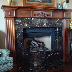 Fireplace Mantels and Surrounds - Traditional fireplace mantel with fluted surround.