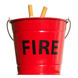 Suck Uk - Fire Bucket Ashtray - There's no playing with fire at your house. Put your cigarettes out safe and sound with this nifty red fire bucket ashtray. Made out of enameled steel, it's a cute addition to your backyard or patio and a fresh alternative to the classic ashtray.