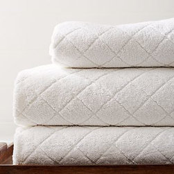 Diamond Sculpted Hand Towel, White - A stack of our sculpted towels is aesthetically soothing and spa-like. Made of pure Turkish cotton, they're super soft and absorbent. Made of pure cotton. 600-gram weight. Machine wash. Made in Turkey.