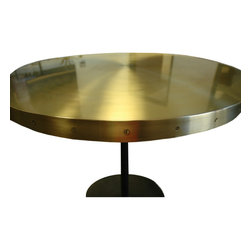 Ace Hotel - Round brass table with removable top.