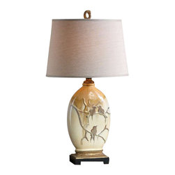 Uttermost Pajaro Aged Ivory Lamp - Aged ivory ceramic with metallic bronze drip, blue green accents and gilded gold details. Aged ivory ceramic with metallic bronze drip, blue green accents and gilded gold details. The oval, slightly tapered hardback shade is an off white linen fabric.
