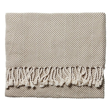 Serena & Lily - Herringbone Throw  Stone - Though I'm usually a fan of more colorful throws, this neutral one would look nice layered on top of breezy, white bedding.