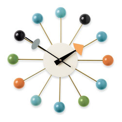 Vitra - Nelson Ball Clock - The Ball Clock (1949) was the first of more than 150 clocks designed by George Nelson Associates for the Howard Miller Clock Company, which sold them from 1949 into the 1980s. Nelson Associates, first launched as a studio by George Nelson in 1947 in New York City, employed some of the most celebrated designers of the time, including Irving Harper, Don Ervin and Charles Pollock, all of whom contributed to the clocks. Until its closure in the mid-1980s, the company designed a range of products for many clients, including Herman Miller, Inc., which was established in 1923 by Howard Miller's brother-in-law, D.J. De Pree. A bit of family history: De Pree also founded the Herman Miller Clock Company in 1926 but turned it over in 1937 to Howard, who renamed it. As for the identity of Herman Miller, he was Howard's father and De Pree's father-in-law. The Ball Clock appeared in the original Miller brochure as Model 4755. This is an authentic Nelson Clock, produced by Vitra Design Museum. Uses one AA battery (included). Made in Poland. The Ball Clock in Walnut is a DWR Exclusive. The Ball Clock in Natural or Black/Brass includes a second hand.