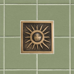 "4"" Solid Bronze Wall Tile with Sunshine Design - This 4"" wall tile will features a whimsical sun design that is sure to brighten any kitchen or bathroom. Made of solid bronze, this tile is offered with an optional tile frame for a custom look."