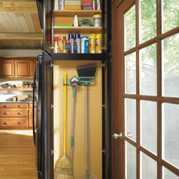 Diamond Shallow Depth Utility Cabinet with Broom Loops - This utility makes great use of the end-of-cabinet run and keeps your cleaning supplies close at hand because you never know when a mess might pop up.