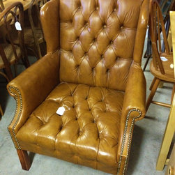 Inventory - Tufted brown leather arm chair.