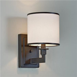 Soft Contemporary Sconce - This simple sconce with a metal band on the shade will look smart when placed on either side of a simple mirror.